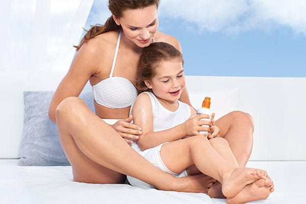 Apply kids sunscreen spray
